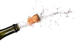Apertura de una botella de champange Foto de archivo libre de regalías