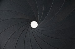 Aperture background. Metal aperture with small hole as background stock images