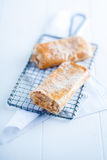 Apfelstrudel or apple strudel on a wire rack Stock Photos