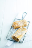 Apfelstrudel or apple strudel on a wire rack Royalty Free Stock Image