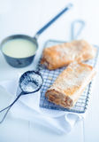 Apfelstrudel or apple strudel on a wire rack Stock Photo