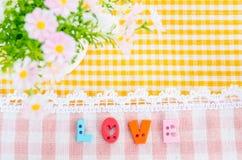 Aphabet d'amour avec la fleur Photographie stock