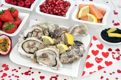 Aphrodisiac Food for Valentines Day. Valentines day aphrodisiac food for good sexual health featuring oysters on distressed white wood background royalty free stock photos
