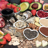 Aphrodisiac Love Food. And drink selection to promote good sexual health forming a background royalty free stock photos
