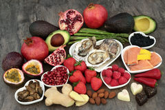 Aphrodisiac Love Food. Large aphrodisiac food selection for good sexual health over marble background stock photo