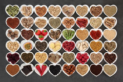 Aphrodisiac Love Food. Aphrodisiac food sampler of foods to promote sexual health in heart shaped china bowls on slate background stock images