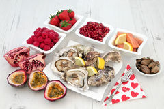 Aphrodisiac Love Food. Selection for good sexual health over distressed white wood background stock photography