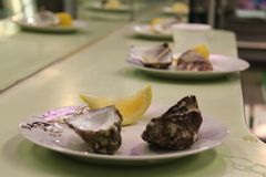 Aphrodisiac O`clock. Oysters and fresh wedge of Lemon stock photo