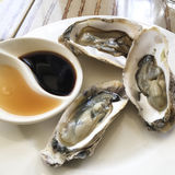 Aphrodisiac oyster. Picture of Aphrodisiac oyster served on the table with condiments royalty free stock image