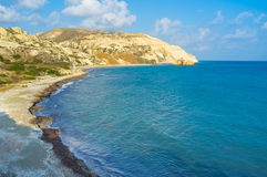 The Aphrodite's harbor. One of the most beautiful beachs in Cyprus surrounded by white rocks with the bright blue sea, Aphrodite's harbor, Paphos, Cyprus Royalty Free Stock Images