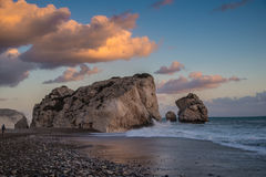 Aphrodite's Rock - Cyprus. Petra tou Romiou (Rock of the Greek), also known as Aphrodite's Rock.  Stone stack on beach in Pafos (Cyprus) against beautiful clouds Royalty Free Stock Photo