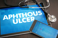 Aphthous ulcer (cutaneous disease) diagnosis medical concept on. Tablet screen with stethoscope Stock Images