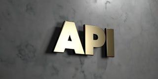 API - χρυσό σημάδι που τοποθετείται στο στιλπνό μαρμάρινο τοίχο - τρισδιάστατο δικαίωμα ελεύθερη απεικόνιση αποθεμάτων Στοκ Φωτογραφία