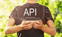 API concept with man holding his smartphone stock photos