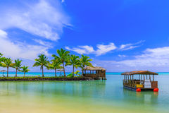 Apia, Samoa. Hut and boat by the beach Royalty Free Stock Photos