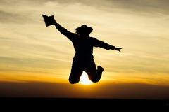 Apiarist jumping at susnset Stock Photos