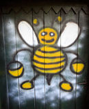 Apiary door. Artwork on old fashioned apiary Royalty Free Stock Photography