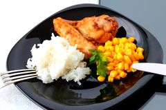 Apiece of roast chicken with rice and corn Royalty Free Stock Photography