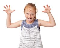 Aping ginger girl making scaring gesture. By the hands and showing the tongue, isolated on white background Royalty Free Stock Image