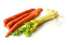 Apio y zanahorias imagen de archivo