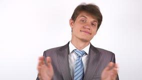 Aplauso sarcasticamente homem novo que aplaude vídeos de arquivo