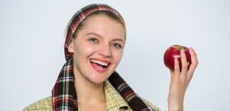 An aple a day keeps doctor away. vitamin and dieting food. orchard, gardener girl with apple basket. Happy woman eating stock photo