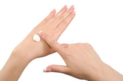 Aplicación de la crema de la mano. foto de archivo