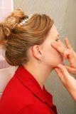 Aplicación de la crema hidratante de la cara Fotos de archivo libres de regalías