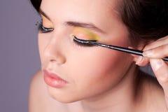 Aplicación de maquillaje foto de archivo