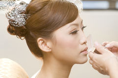 Aplicación de maquillaje fotos de archivo libres de regalías