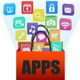 Aplicaciones en un bolso de compras Foto de archivo libre de regalías