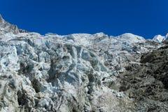 Apline glacier blue ice fall Royalty Free Stock Image