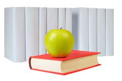 Aplle, closed red book and row of gray books. Closed Red Book with Green Apple ahead of row gray books Stock Images