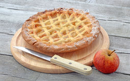 Aplle pie on cutting board Royalty Free Stock Photo