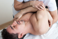 Apllied chiropractic manipulation. Physic therapist applying chiropractic manipulation Royalty Free Stock Photo