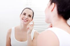 Apllying cream on face skincare Royalty Free Stock Photo