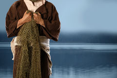 Aplostle Fisherman Holding Nets. Apostle and fisherman holding nets with lake in background stock photography