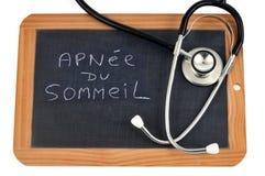 Apnea de sueño escrito en francés fotos de archivo