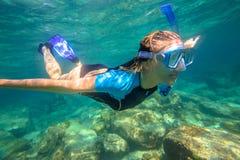 Apnea in tropical sea. Close up of female apnea swims in tropical turquoise sea of Racha Noi, Phuket in Thailand Stock Photos