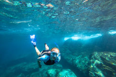 Apnea in tropical sea. Female apnea swims in deep waters of the popular Similan Islands in Thailand, Andaman Sea Royalty Free Stock Photo