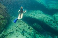 Apnea in tropical sea. Female apnea swims in deep waters of the popular Similan Islands in Thailand, Andaman Sea Royalty Free Stock Photography