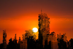 Apocalypse City Ruins Sunset Background. A sunrise or sunset casts an ominous red glow over a city of ruins in this background illustration. The abstract concept Stock Photo