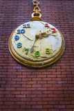 Apocalypse concept - Decorative pocket clock on a red bricks wall with peeled paint Royalty Free Stock Images