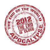 Apocalypse grunge rubber stamp. Red grunge rubber stamp with the text 2012 the end of the world written inside the stamp. Apocalypse concept Stock Photography