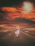 Apocalypse. Little girl walking along empty road with desolate environment around her. Apocalyptic theme royalty free stock photos