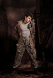 Apocalypse soldier. Soldier in chemical protection armor with ruins in background. Final of war Stock Photo