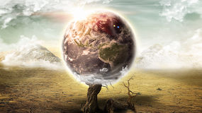 Apocalyptic Earth on desert landscape (Elements of this image furnished by NASA) Stock Photo
