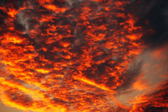 Apocalyptic orange clouds in winter sunset. Beauty in nature Stock Photo