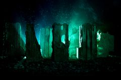 Apocalyptic ruins of the city. Disaster effect. Night scene. City destroyed by war. Destroyed skyscrapers Royalty Free Stock Images
