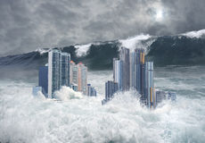 Apocalyptic scene of city submerged by tsunami. Apocalyptic scene of modern city's skyscrapers submerged by tsunami with a giant second wave coming royalty free stock photos